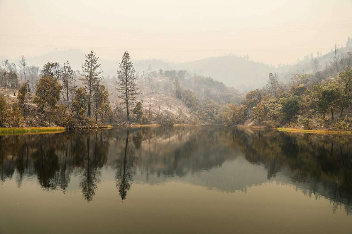 Graddock Gulch, a small body of water over CA 299 is covered in smoke during the Carr Fire in Redding, California, on Saturday, July 28, 2018.
