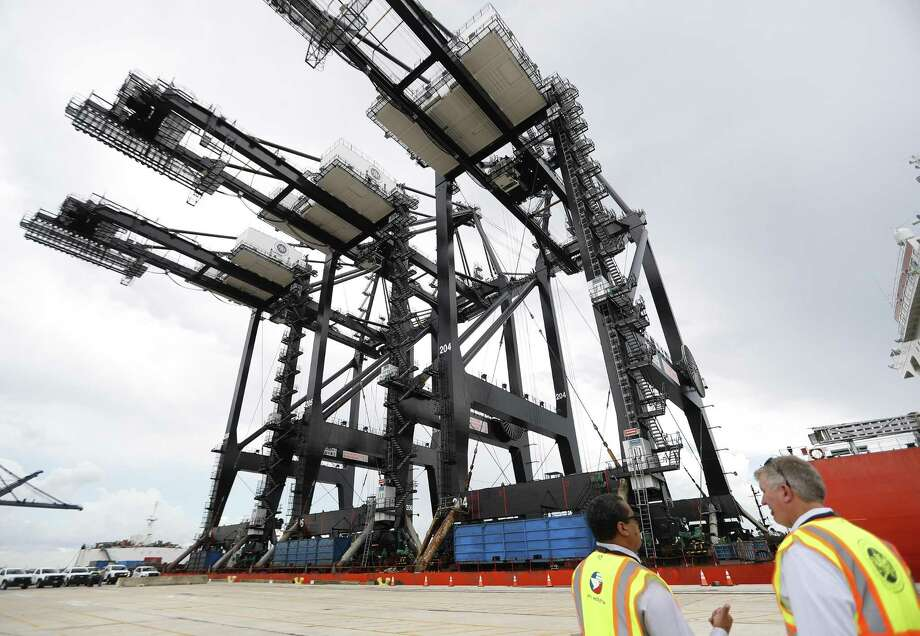 Commissioner Theldon R. Branch III, left, and  Executive Director Roger Guenther watch as Port Houston received its new super post-panamax cranes as they completed their nearly 90-day journey from Shanghai, China to the Bayport Container Terminal, in Seabrook, Tuesday, August 7, 2018. Photo: Karen Warren, Staff Photographer / Houston Chronicle / © 2018 Houston Chronicle