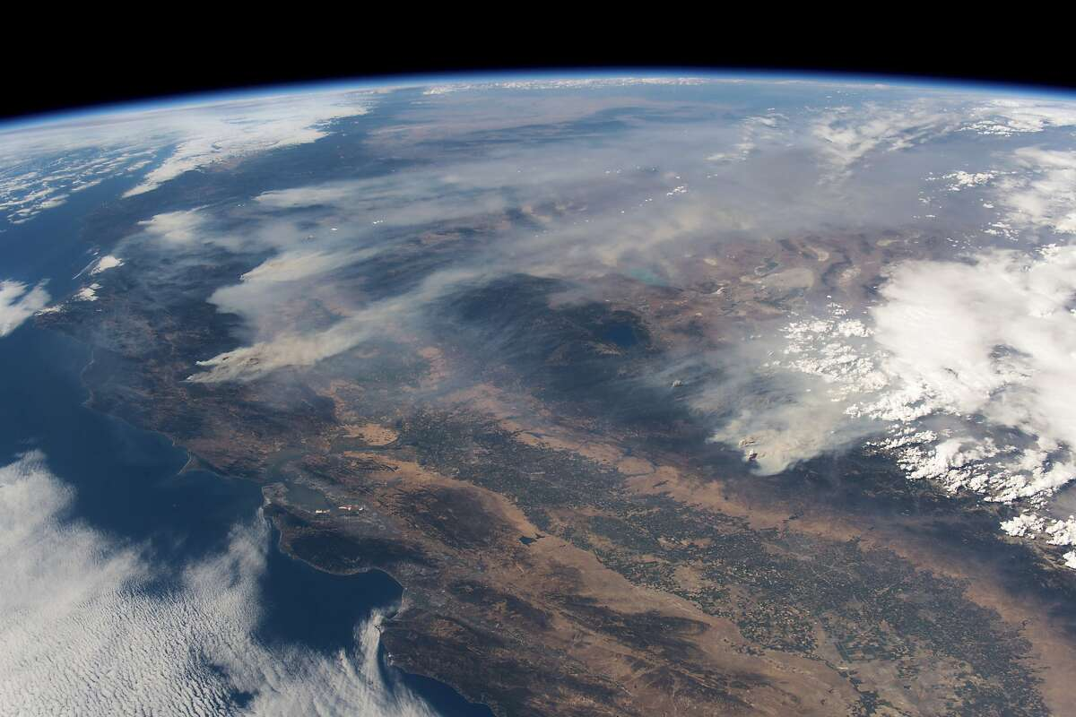 In a photo provided by the astronaut Alexander Gerst of the European Space Agency, seen from the International Space Station, plumes of smoke from various wildfires burn in northern California, on Aug. 2, 2018. The largest wildfire in California's history continued to rage Aug. 7, after steadily growing for nearly two weeks. Unprecedented in scope, the Northern California fire, called the Mendocino Complex, has already consumed roughly 980 square miles and forced tens of thousands of people from their homes. (Alexander Gerst/European Space Agency via The New York Times) -- FOR EDITORIAL USE ONLY. --