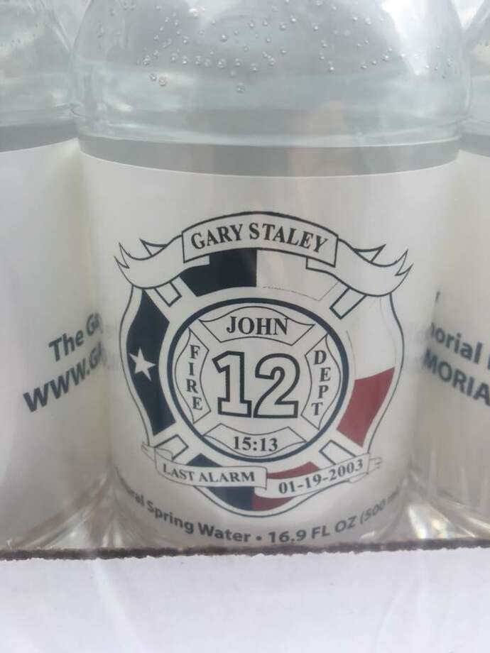 Each water bottle is emblazoned with a patch bearing Gary Staley's name and the website address. Photo: Courtesy Of Porter Fire Department