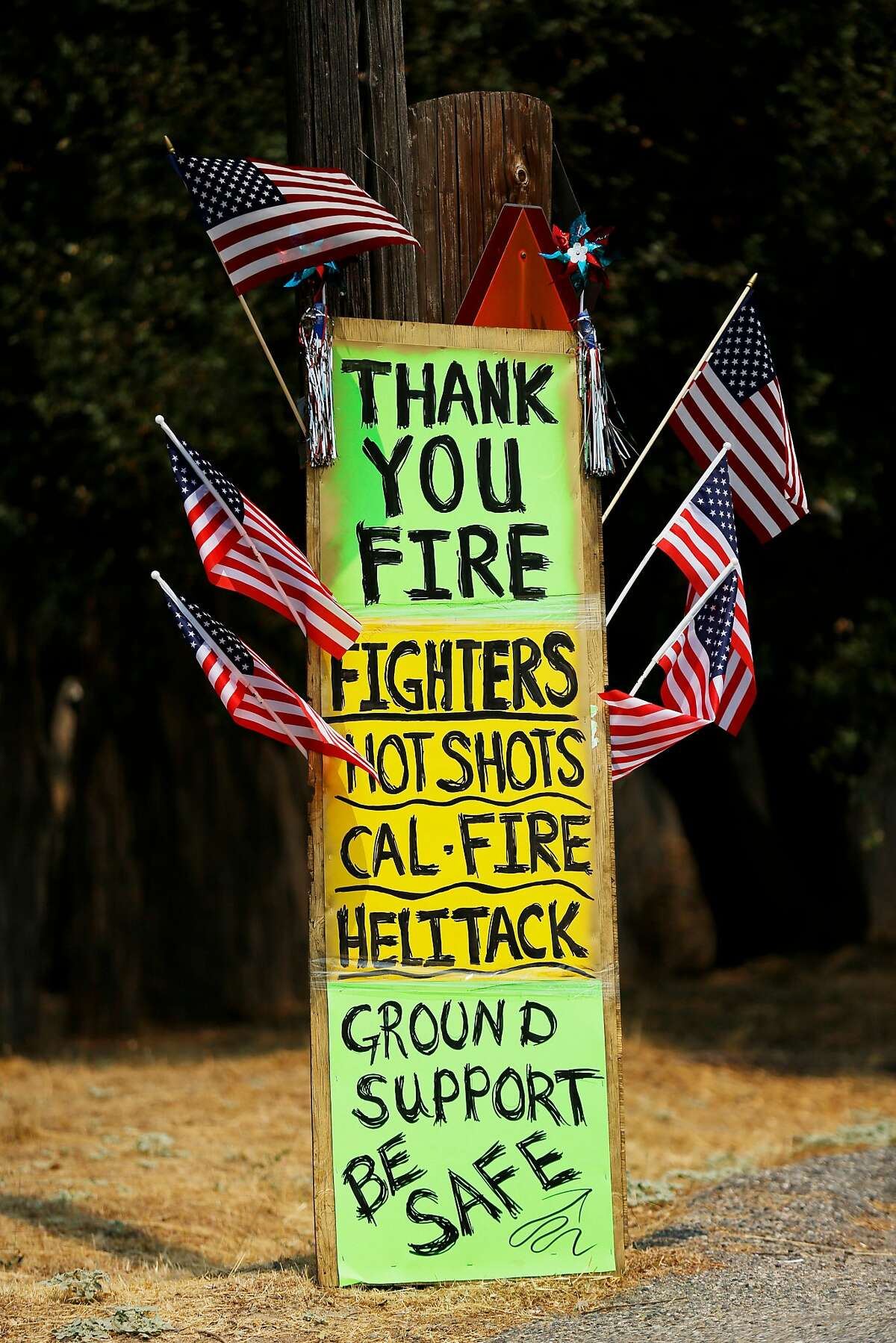 Signs along Highway 49 thank fire officials on Tuesday, Aug. 7, 2018, in Mariposa, Calif.