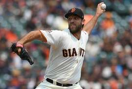 SAN FRANCISCO, CA - AUGUST 07:  Madison Bumgarner #40 of the San Francisco Giants pitches against the Houston Astros in the top of the second inning at AT&T Park on August 7, 2018 in San Francisco, California.  (Photo by Thearon W. Henderson/Getty Images)