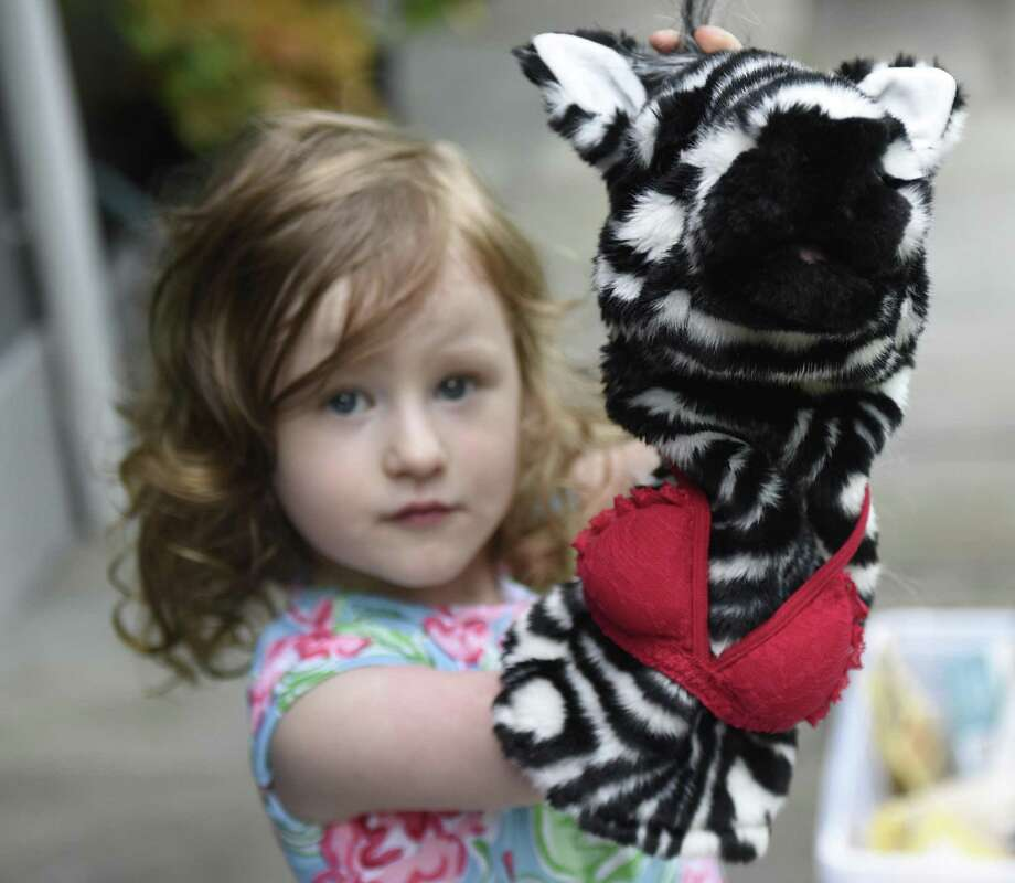 "Henley Belle Johnson, 3, plays with a zebra puppet wearing a bra, a reference to her new kids joke book ""What Underwear Does A Zebra Wear?"" at her home in Greenwich, Conn. Monday, Aug. 6, 2018. Henley and her mother, Elle Muliarchyk, came up with jokes in the new book, which was released in early July and has become an Amazon bestselling children's joke book. Muliarchyk said of the zebra's bra, ""By the way, it's Calvin Klein. At first, I made it flat, but it wasn't that funny. I made it a C-cup, because I wanted to make it more relatable."" Photo: Tyler Sizemore / Hearst Connecticut Media / Greenwich Time"