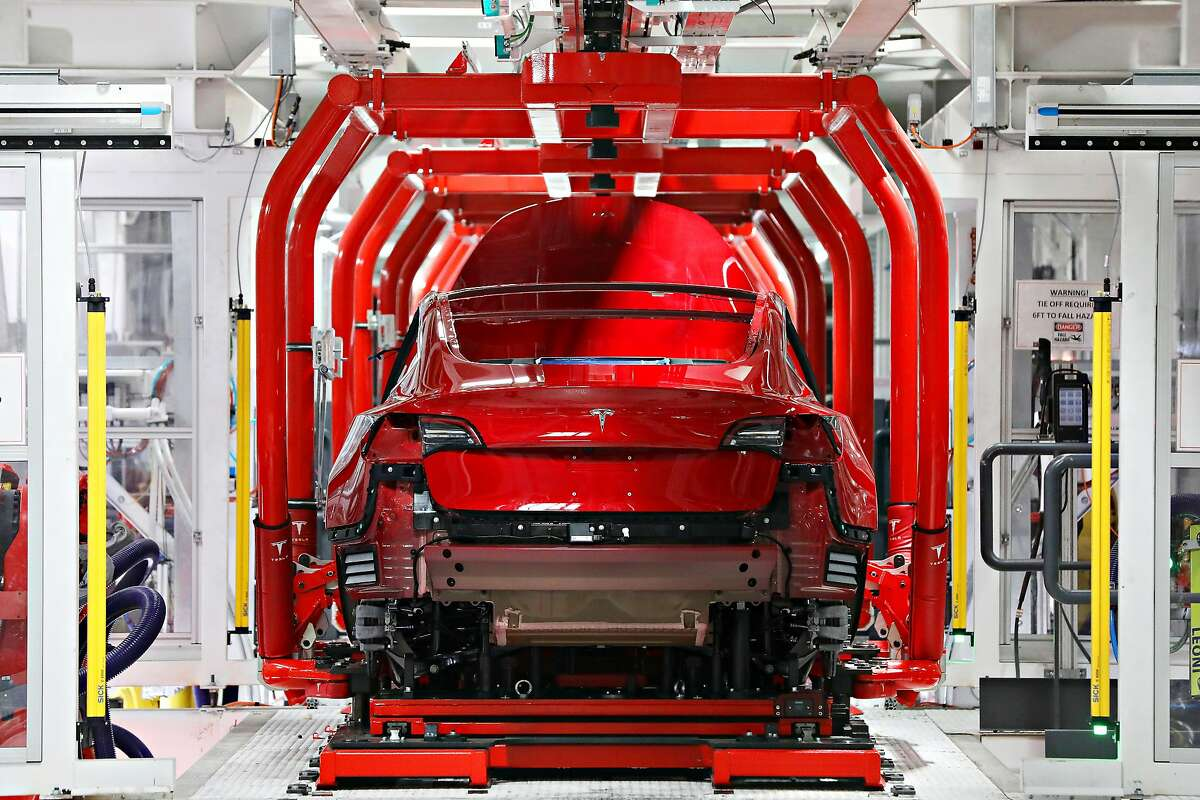 A Tesla Model 3 is seen on the assmebly line at the Tesla factory on Wednesday, July 18, 2018 in Fremont, Calif.