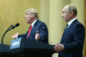 US President Donald Trump and Russia's President Vladimir Putin give a joint news conference following their meeting at the Presidential Palace. Helsinki, Finland, July 16. Trump's willingness to side with Putin over his own intelligence agencies is puzzling.
