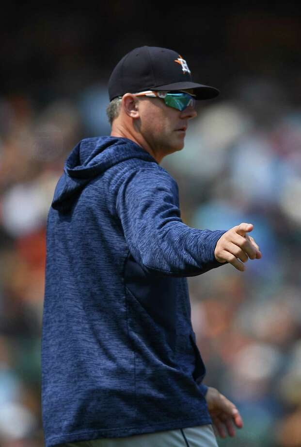 SAN FRANCISCO, CA - AUGUST 07:  Manager AJ Hinch #14 of the Houston Astros signals the bullpen to make a pitching change against the San Francisco Giants in the bottom of the seventh inning at AT&T Park on August 7, 2018 in San Francisco, California. Photo: Thearon W. Henderson, Getty Images / 2018 Getty Images