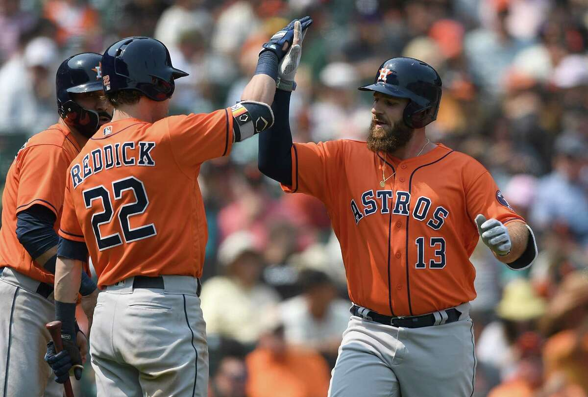 PHOTOS: Shots from the Astros 2-1 win in San Francisco on Tuesday SAN FRANCISCO, CA - AUGUST 07: Tyler White #13 of the Houston Astros is congratulated by Josh Reddick #22 after White hit a two-run home run against the San Francisco Giants in the top of the eighth inning at AT&T Park on August 7, 2018 in San Francisco, California.