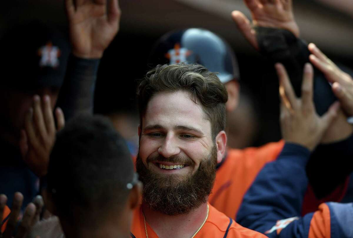 SAN FRANCISCO, CA - AUGUST 07: Tyler White #13 of the Houston Astros is congratulated by teammates after he hit a two-run home run against the San Francisco Giants in the top of the eighth inning at AT&T Park on August 7, 2018 in San Francisco, California.