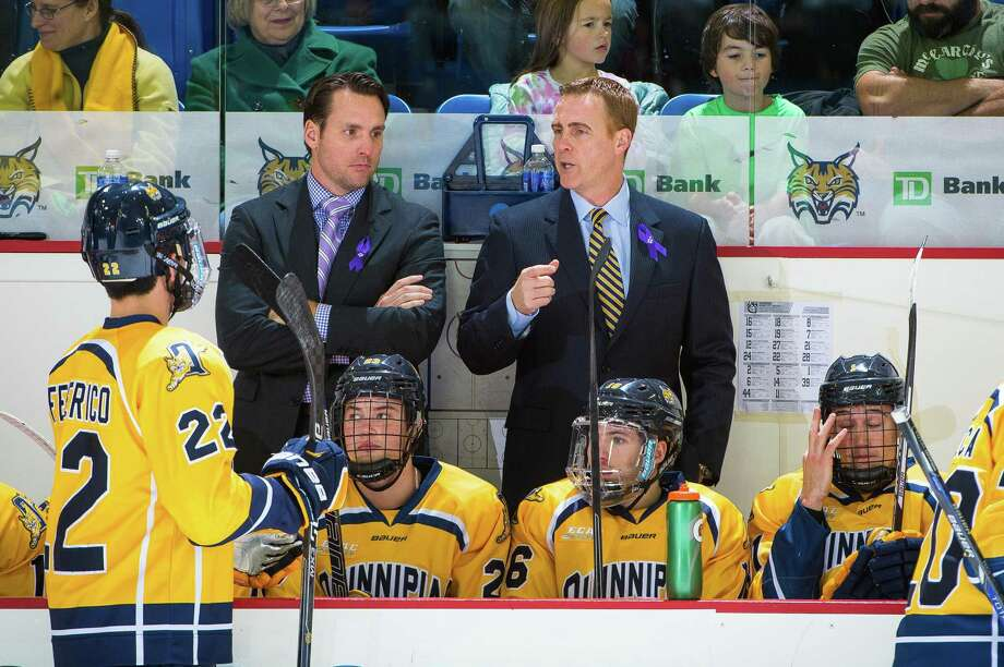Former Quinnipiac All-American and assistant coach Reid Cashman, left, speaks with head coach Rand Pecknold behind the bench. Cashman was hired to first NHL job, as an assistant for the defending Stanley Cup champion Washington Capitals. Photo: Qunnipiac Athletics / Stamford Advocate Contributed