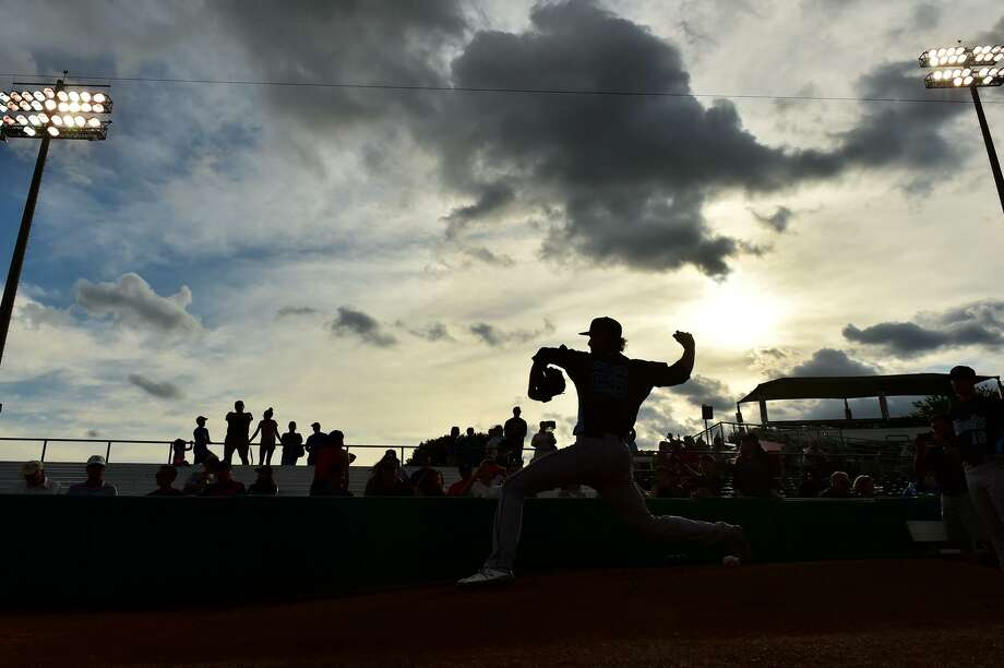 Forrest Whitley of the Corpus Christi Hooks warms up  during his return to San Antonio to face the Missions Monday night Photo: Robin Jerstad, Freelance / ROBERT JERSTAD