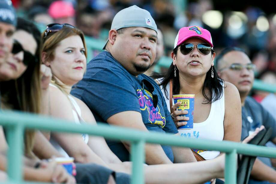 Lydia Bueno, right, and Nathan Bueno enjoy the the Flying Chanclas' game with Tulsa in their chanclas gear at Wolff Stadium on May 24. The AA Missions team is moving to Amarillo and San Antonio is getting a new AAA Missions. Photo: Marvin Pfeiffer /San Antonio Express-News / Express-News 2018