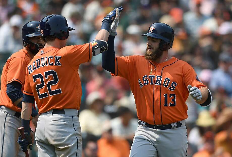 SAN FRANCISCO, CA - AUGUST 07:  Tyler White #13 of the Houston Astros is congratulated by Josh Reddick #22 after White hit a two-run home run against the San Francisco Giants in the top of the eighth inning at AT&T Park on August 7, 2018 in San Francisco, California.  (Photo by Thearon W. Henderson/Getty Images) Photo: Thearon W. Henderson, Getty Images