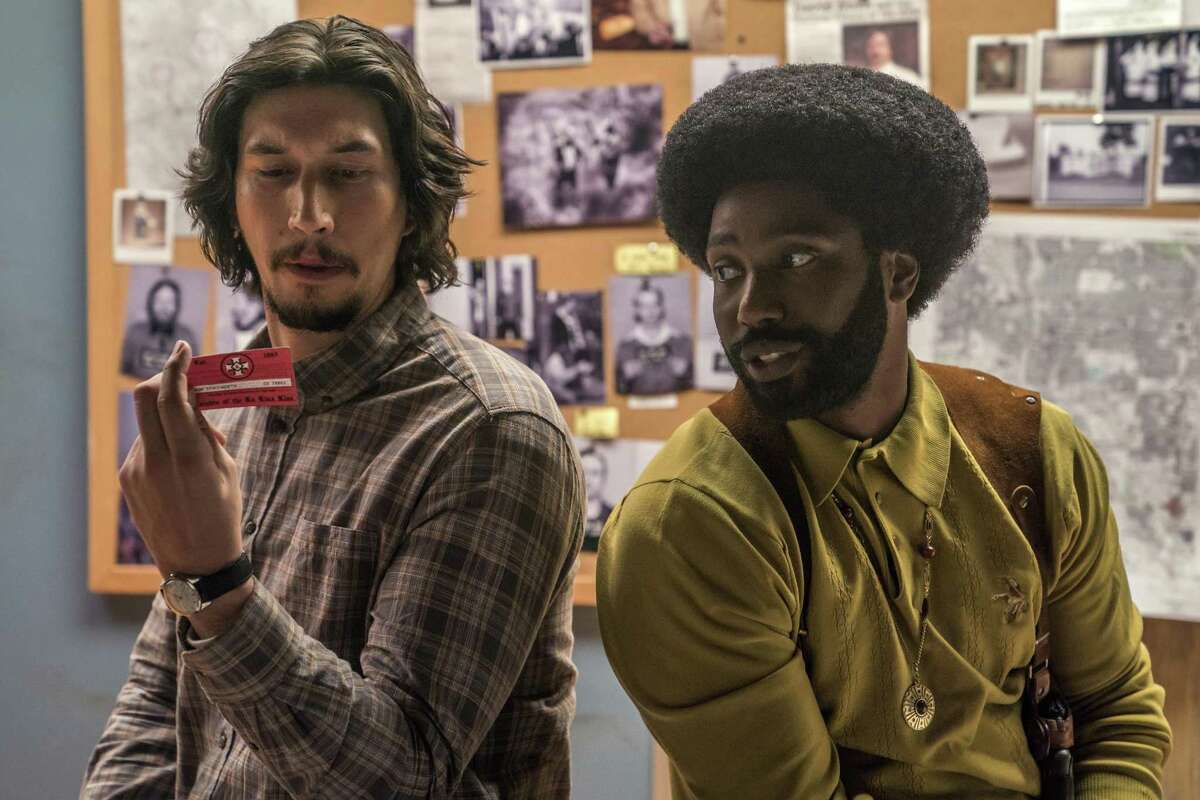 "Adam Driver (left) and John David Washington in ""BlacKkKlansman."""
