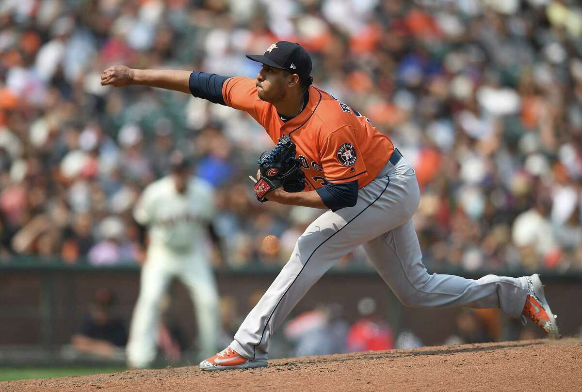 SAN FRANCISCO, CA - AUGUST 07: Hector Rondon #30 of the Houston Astros pitches against the San Francisco Giants in the bottom of the ninth inning at AT&T Park on August 7, 2018 in San Francisco, California. Astros won the game 2-1.