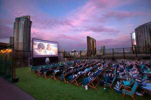 Moviegoers enjoy a film at a Rooftop Cinema Club venue in San Diego.