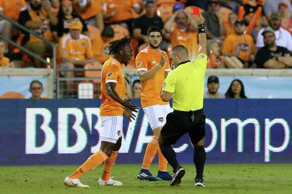 The Dynamo were hit with three red cards Saturday against Sporting Kansas City, including one to Alejandro Fuenmayor, center, that left Alberth Elis incensed.