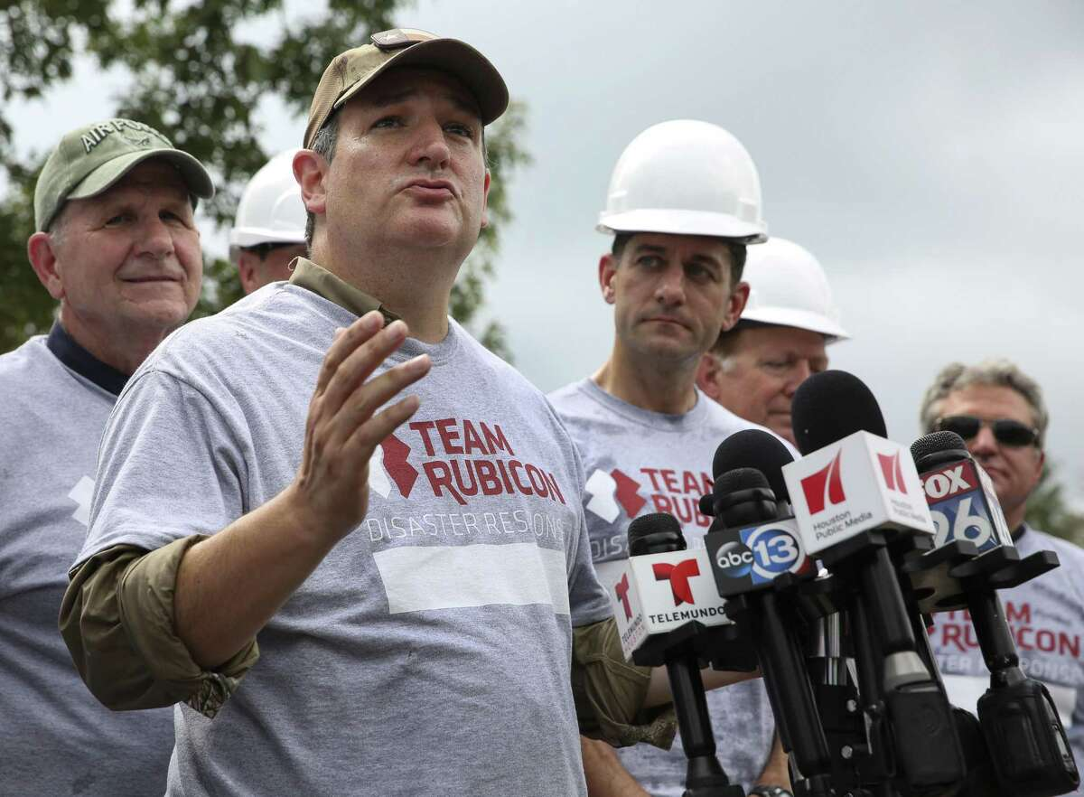 Sen. Ted Cruz talks to the press about Hurricane Harvey and disaster relief with a group of Congressional delegation Thursday, Sept. 21, 2017, in Friendswood. The group of Congressional delegation came to assist Team Rubicon Disaster Response, a non-profit organization that pairs military veterans with first responders to deploy emergency response team, to clean out the Harvey-damaged Garcia house on Lucian Lane.
