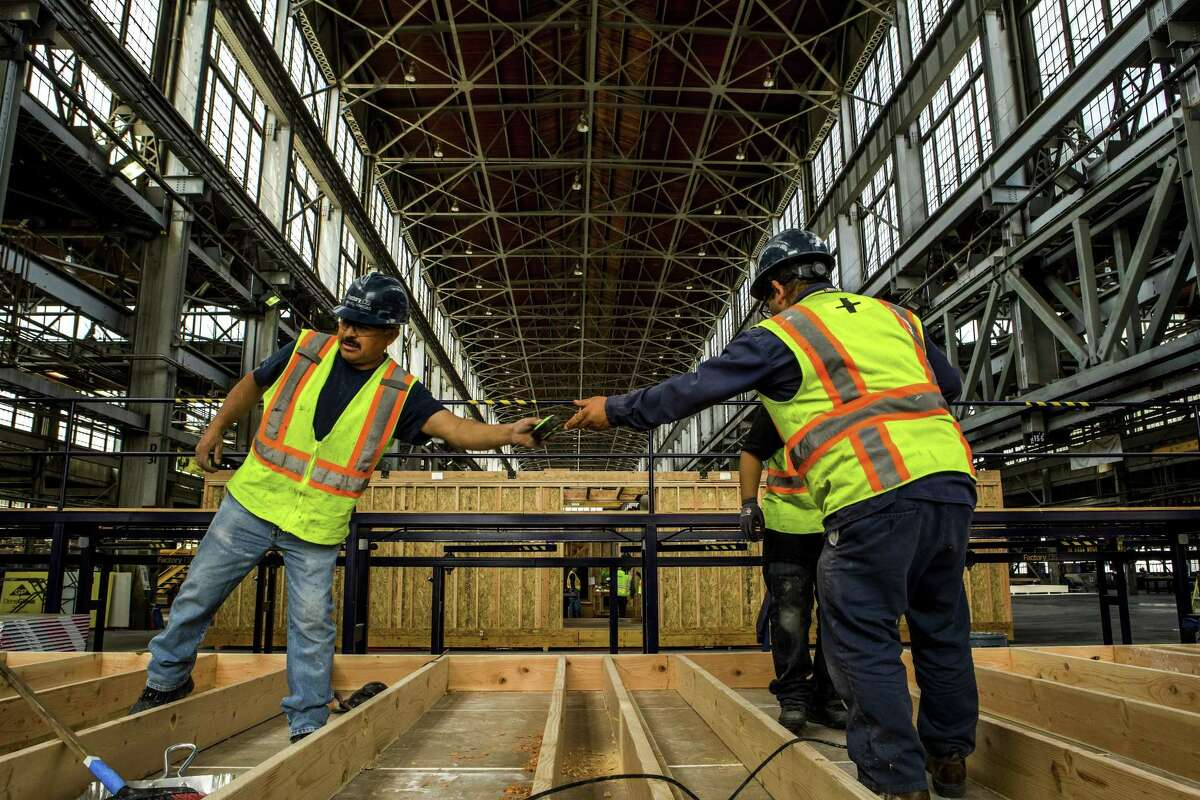 Modular homes are built at a factory in Vallejo, Calif., April 27, 2018. A tight labor market should give workers some leverage to push for higher wages, but hourly earnings have moved forward at a crawl.