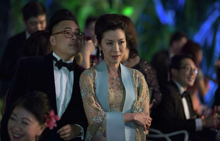"Nick Santos as Oliver and Michelle Yeoh as Eleanor in Warner Bros. Pictures' and SK Global Entertainment's and Starlight Culture's contemporary romantic comedy ""CRAZY RICH ASIANS,"" a Warner Bros. Pictures release. Photo: Sanja Bucko / Warner Bros. Pictures / © 2017 Warner Bros. Entertainment Inc. and RatPac-Dune Entertainment LLC"