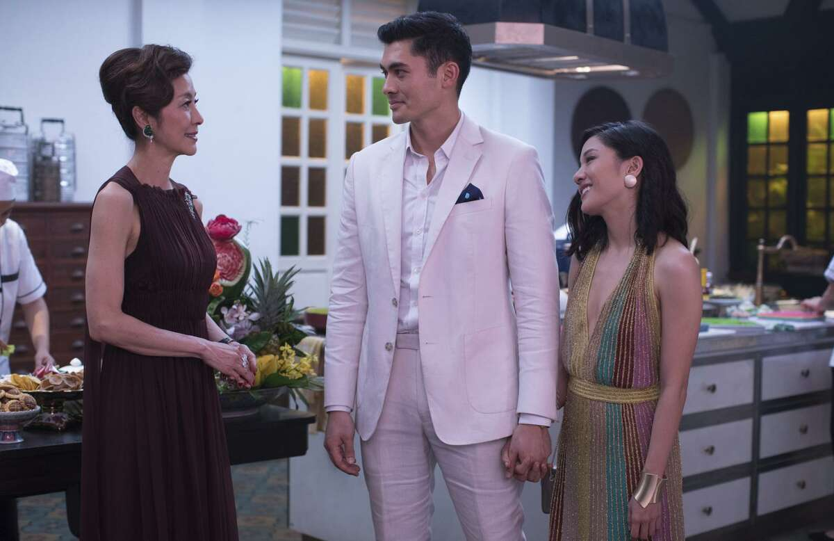 Michelle Yeoh plays the mother of Nick (Henry Golding), the heir dating his colleague (Constance Wu).