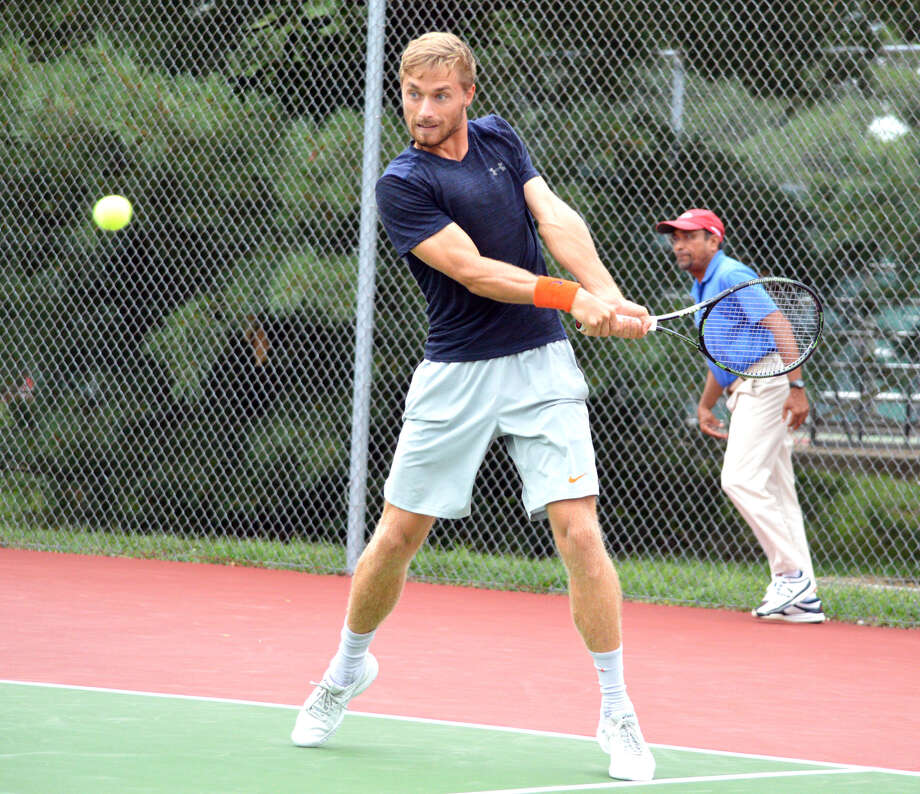 Tim Kopinski hits a two-handed backhand during his doubles match on Tuesday at the Edwardsville Futures. Kopinski is a former player at the University of Illinois. Photo: Scott Marion