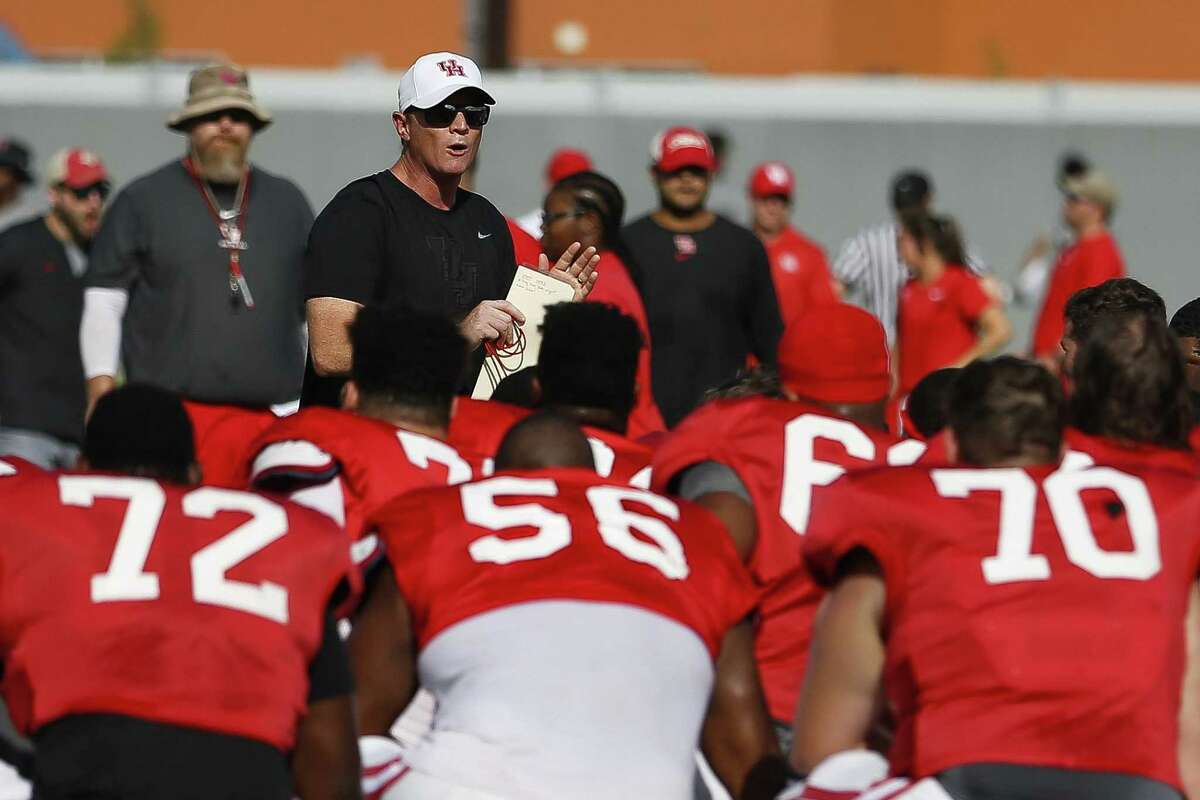 University of Houston football coach Major Applewhite addresses his team during practice Tuesday Aug. 7, 2018 in Houston.