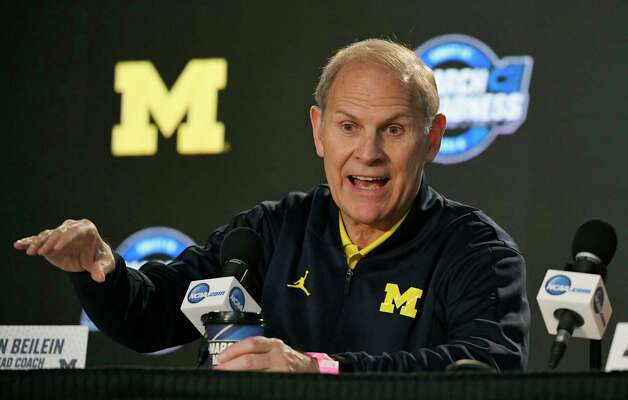 FILE - In this March 21, 2018, file photo, Michigan head coach John Beilein speaks during a news conference at the NCAA men's college basketball tournament, in Los Angeles. After briefly emerging as a candidate for the Detroit Pistons' job, John Beilein is back at Michigan amid high expectations for next season.  (AP Photo/Mark J. Terrill, File) Photo: Mark J. Terrill / Copyright 2018 The Associated Press. All rights reserved.