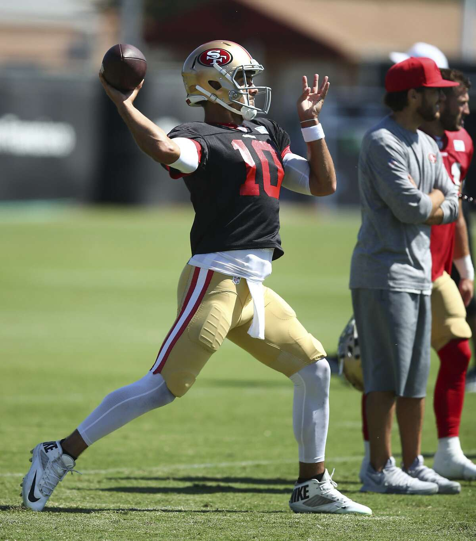 San Francisco 49ers quarterback Jimmy Garoppolo throws a pass during NFL football practice at the team's headquarters Thursday, Aug. 2, 2018, in Santa Clara, Calif. (AP Photo/Ben Margot)