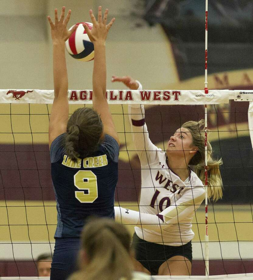 Magnolia West's Rylie Scales (10) gets a shot past Lake Creek's Skyla Roth (9) during the first set of a non-district high school volleyball game at Magnolia West High School on Tuesday, Aug. 7, 2018, in Magnolia. Photo: Jason Fochtman, Staff Photographer / Houston Chronicle / © 2018 Houston Chronicle