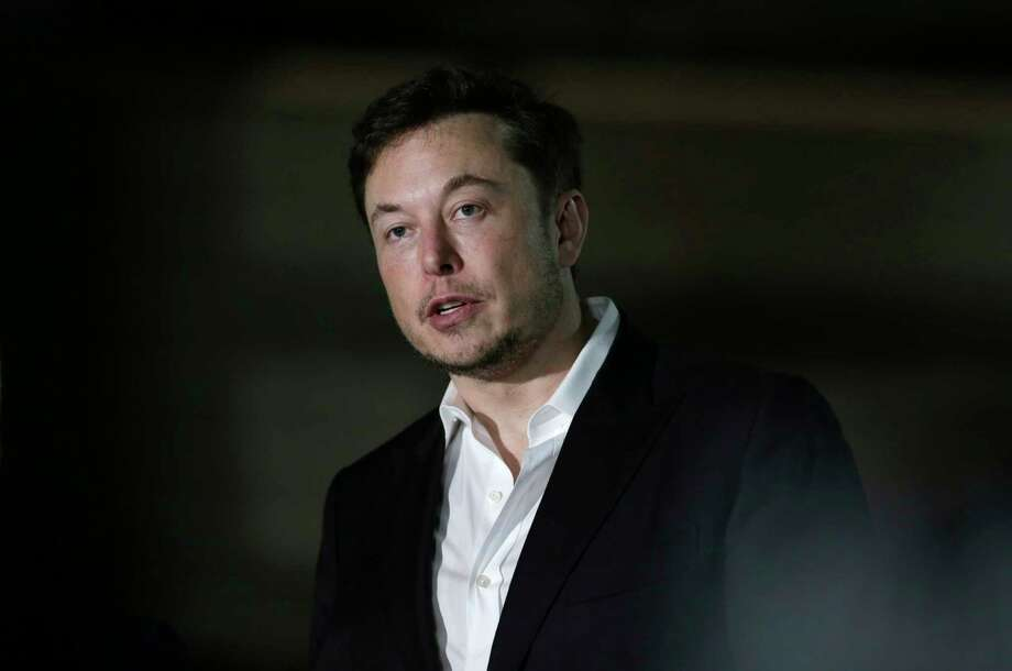 FILE- In this June 14, 2018, file photo Tesla CEO and founder of the Boring Company Elon Musk speaks at a news conference in Chicago. Musk says he is considering taking the electric car maker private. Tesla's stock spiked Tuesday, Aug. 7, after Musk made the abrupt announcement in a terse tweet. (AP Photo/Kiichiro Sato, File) Photo: Kiichiro Sato / Copyright 2018 The Associated Press. All rights reserved.