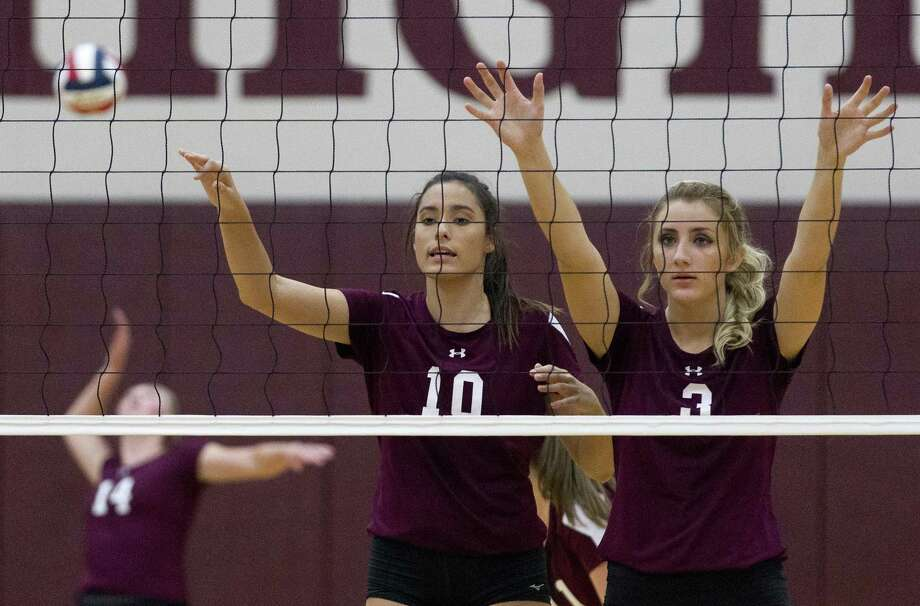 Magnolia's Richelle Carroll (10) is seen beside Toria Dutton (3) as Ellie Anderson serves the ball during the third set of a non-district high school volleyball game at Magnolia High School on Tuesday, Aug. 7, 2018, in Magnolia. Photo: Jason Fochtman, Staff Photographer / Houston Chronicle / © 2018 Houston Chronicle