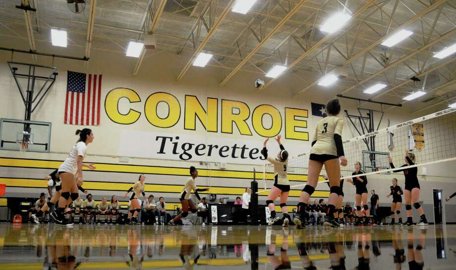 The Conroe  volleyball team sets up its offense against Caney Creek on Tuesday, August 7, 2018, at Conroe High School. Photo: Keith MacPherson