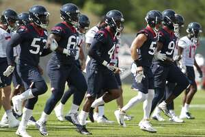 Houston Texans players warm up during training camp at the Greenbrier Sports Performance Center on Tuesday, Aug. 7, 2018, in White Sulphur Springs, W.Va.