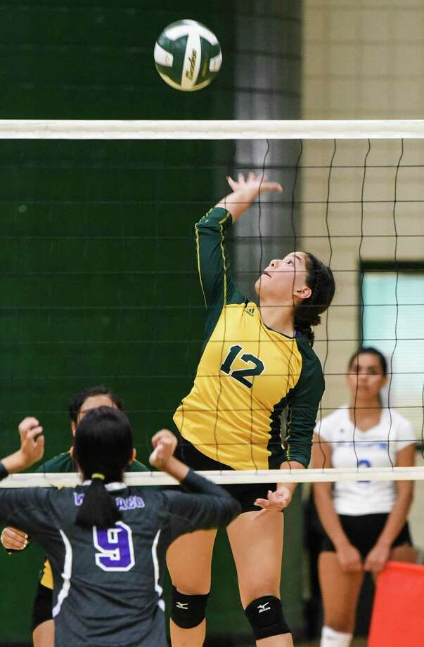 Geraldine Valles combined for 32 kills in a pair of 3-1 victories Wednesday as Nixon beat Alice and Kingsville in a tri-match. Photo: Danny Zaragoza /Laredo Morning Times File