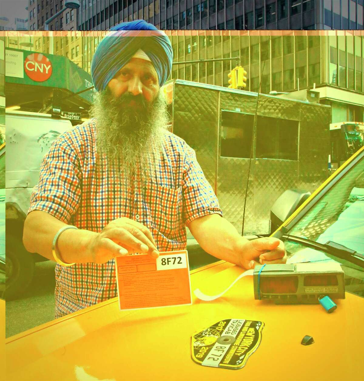 In this Thursday, Aug. 2, 2018 photo, yellow taxi medallion owner Lal Singh shows a license, meter device and the medallion tag required to operate his cab in New York. New York City's yellow cab drivers, thrown into financial upheaval in recent years by the arrival of a veritable army of black cars picking up passengers through ride-hail apps, could be getting a lifeline from elected officials voting on legislation Wednesday, Aug. 8, that would pump the brakes on Uber, Lyft and others. (AP Photo/Bebeto Matthews)