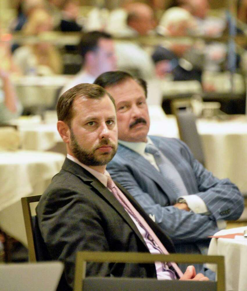 Lobbyists Joseph, left, and Giorgio DeRosa of Bolton-St. John's listen to speakers during the Saratoga Institute on Equine, Racing, and Gaming conference Tuesday August 7, 2018 in Saratoga Springs, NY. (John Carl D'Annibale/Times Union)