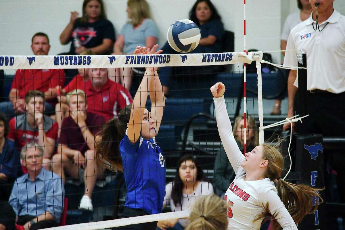Friendswood's Elle McGown (16) goes face-to-face with Clear Lake's Taylor Bess (25) Tuesday night in Friendswood.
