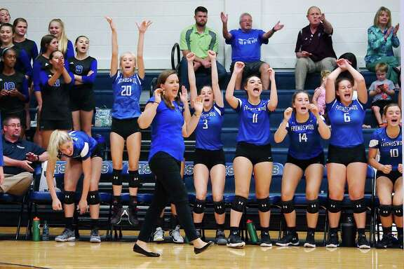 Friendswood volleyball coach Sarah Paulk and the Lady Mustangs celebrate a point against Clear Lake this past week.