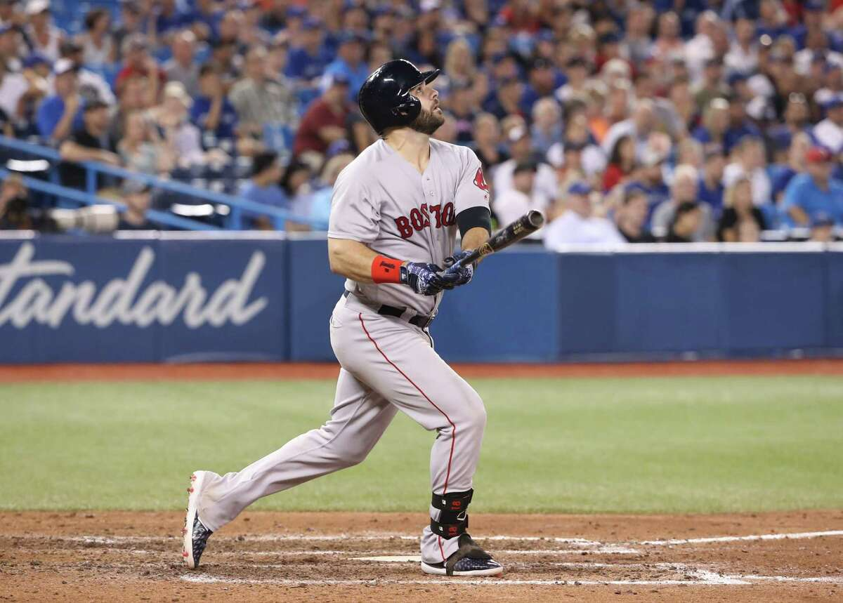 TORONTO, ON - AUGUST 7: Mitch Moreland #18 of the Boston Red Sox hits a three-run home run in the 10th inning during MLB game action against the Toronto Blue Jays at Rogers Centre on August 7, 2018 in Toronto, Canada. (Photo by Tom Szczerbowski/Getty Images)