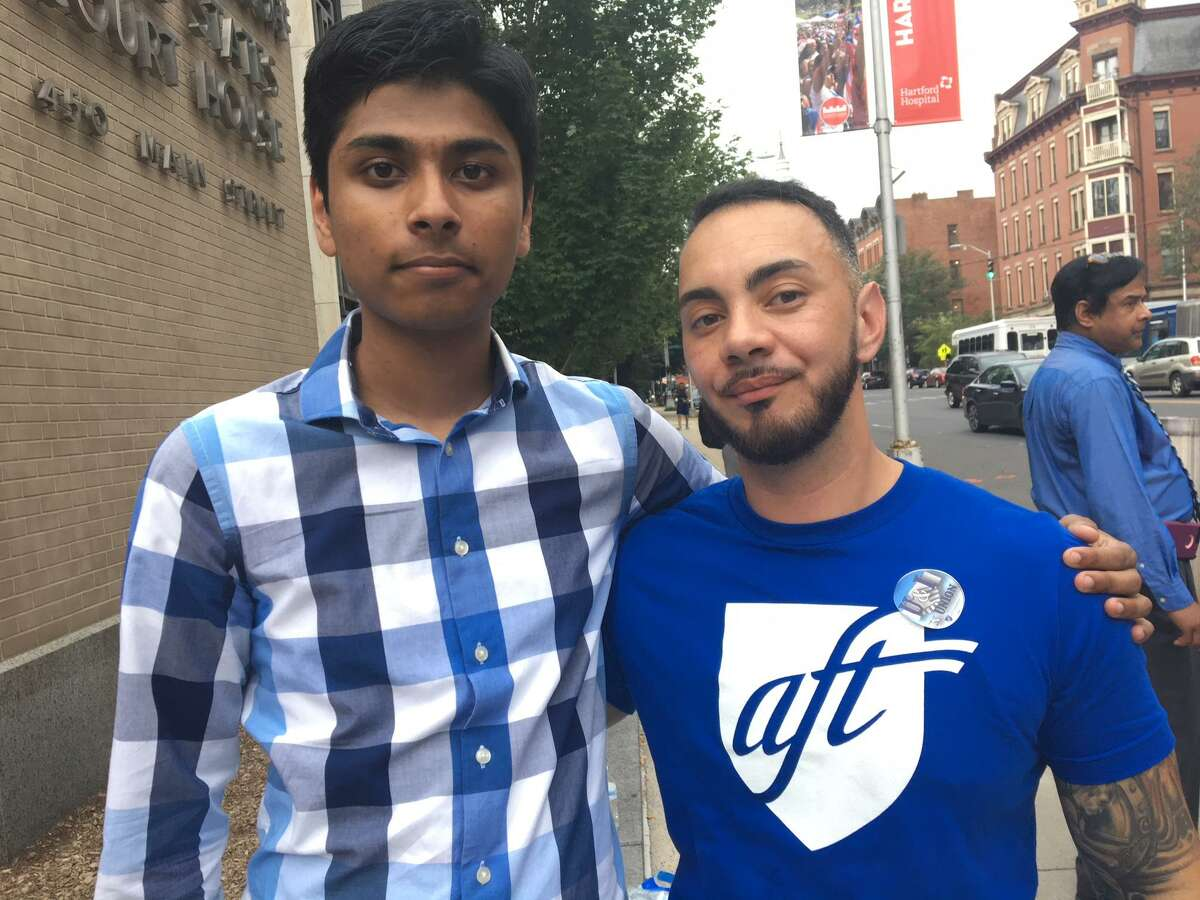 EricMaroney, right, came to the rally to support Samir Mahmud, a student he had at ESMUS, whose mother may be deported.