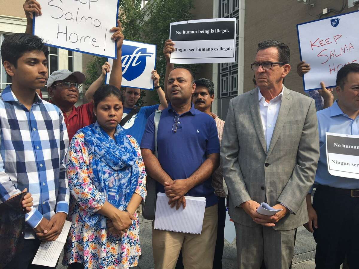 Samir Mahmud, his mother Salma Sikandar, his father Anwar Mahmud attend ICE protest with Gov. Dannel P. Malloy
