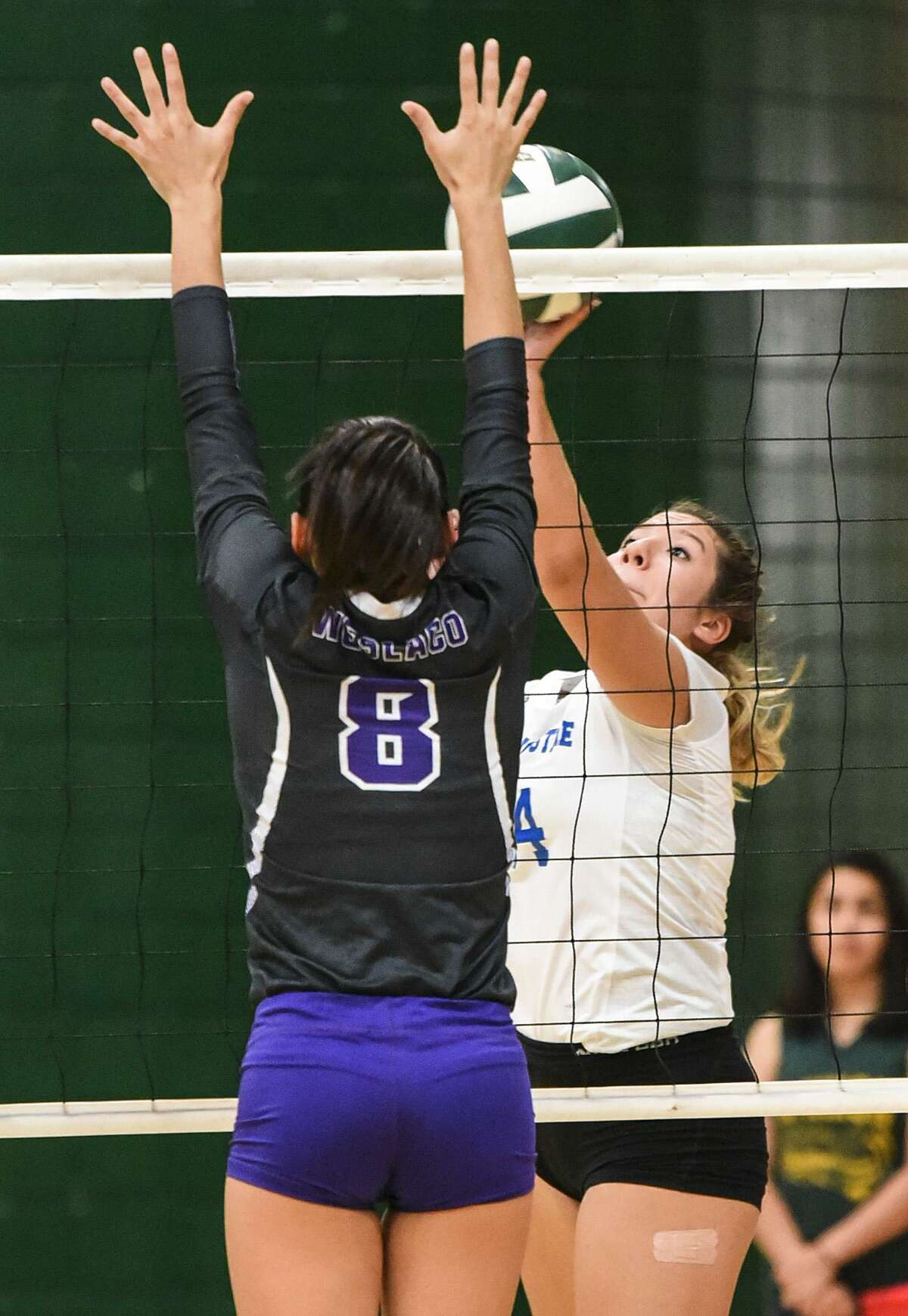 Karla Benavides and St. Augustine rallied from down 0-2 Monday for a 3-2 (17-25, 20-25, 25-12, 25-22, 15-7) win over Cigarroa.