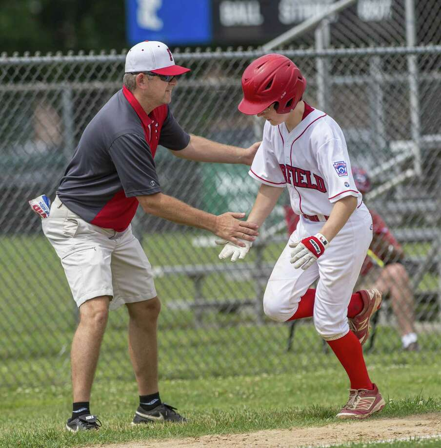 Fairfield American head coach Jeff Gouley congratulates Pierce Cowles as Cowles rounds third after hitting a home run during a district 2 11-12 year olds little league game against Westport played at Unity Park, Trumbull, CT. Sunday, July 1, 2018. Photo: Mark Conrad / For Hearst Connecticut Media / © 2018 Mark F Conrad
