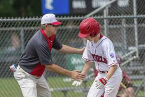 Fairfield American head coach Jeff Gouley congratulates Pierce Cowles as Cowles rounds third after hitting a home run during a district 2 11-12 year olds little league game against Westport played at Unity Park, Trumbull, CT. Sunday, July 1, 2018.