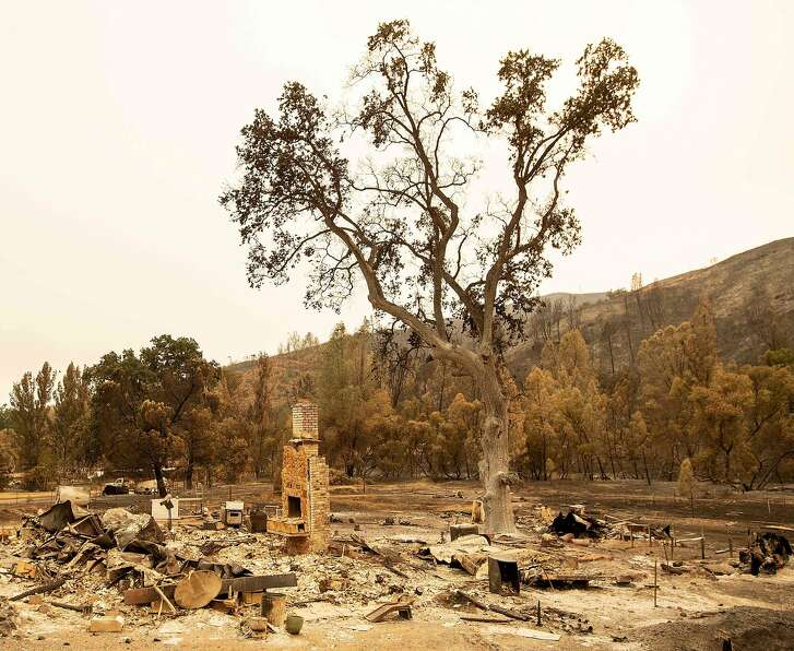 A chimney remains standing at a house destroyed in the Ranch Fire in Spring Valley near Clearlake Oaks, northern California, on August 7, 2018.  Tens of thousands of firefighters battled relentless flames ripping across California on August 7, as the death toll from a series of infernos that erupted last month hit 11. The raging Mendocino Complex fire comprising twin blazes in the western state's north has now ravaged more than 290,000 acres (117,359 hectares) -- approximately the size of sprawling Los Angeles -- in less than two weeks, becoming California's largest wildfire since record-keeping began a century ago. / AFP PHOTO / JOSH EDELSONJOSH EDELSON/AFP/Getty Images
