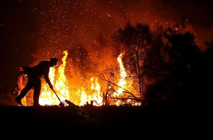 LODOGA, CA - AUGUST 07:  A Cal Fire firefighter monitors a back fire while battling the Medocino Complex fire on August 7, 2018 near Lodoga, California. The Mendocino Complex Fire, which is made up of the River Fire and Ranch Fire, has surpassed the Thomas Fire to become the largest wildfire in California state history with over 280,000 acres charred and at least 75 homes destroyed.  (Photo by Justin Sullivan/Getty Images)