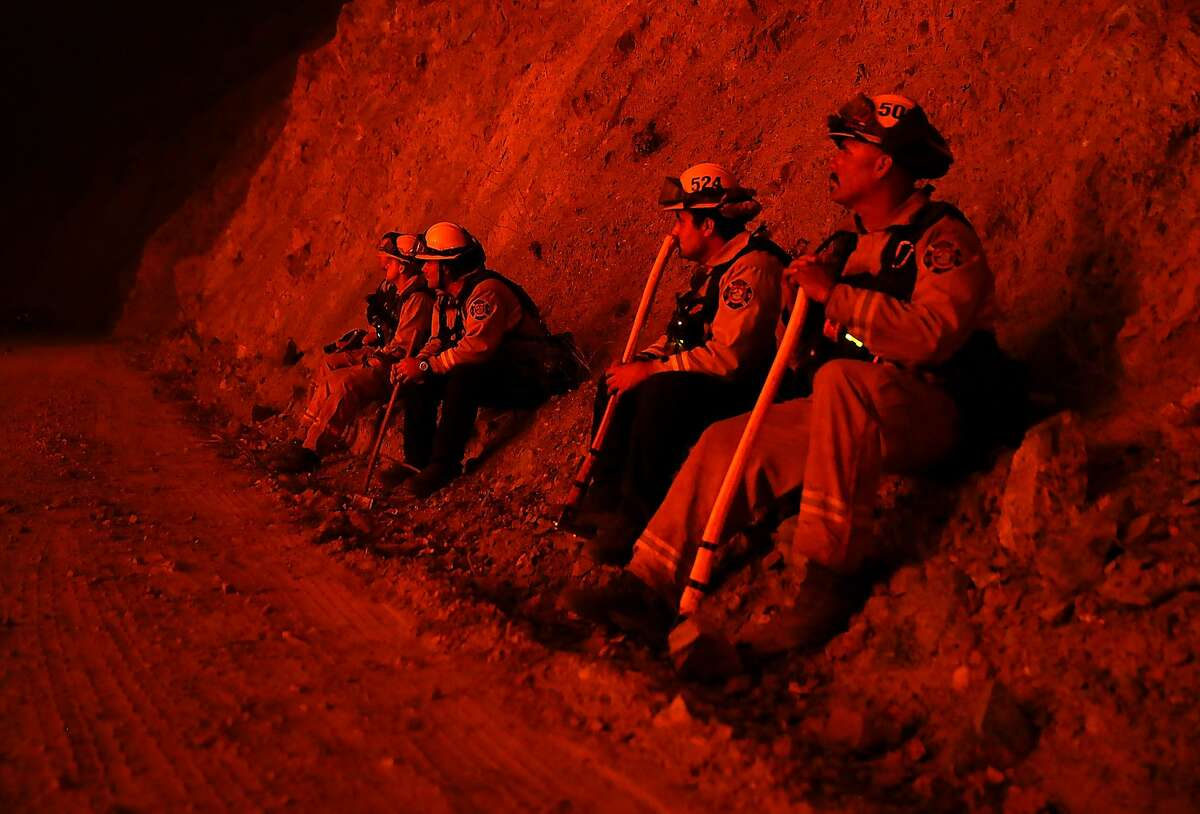 Firefighters monitor a back fire as they battle the Medocino Complex fire on August 7, 2018 near Lodoga, California. The Mendocino Complex Fire, which is made up of the River Fire and Ranch Fire, has surpassed the Thomas Fire to become the largest wildfire in California state history with over 280,000 acres charred and at least 75 homes destroyed.