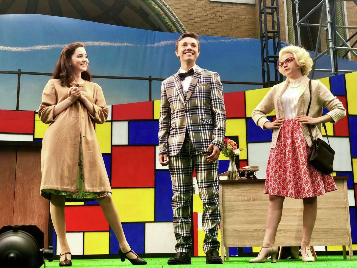 """From left,Elizabeth McGovern, Jake Goodman and Alexis Papaleo in """"How to Succeed in Business Without Really Trying"""" at Park Playhouse II."""