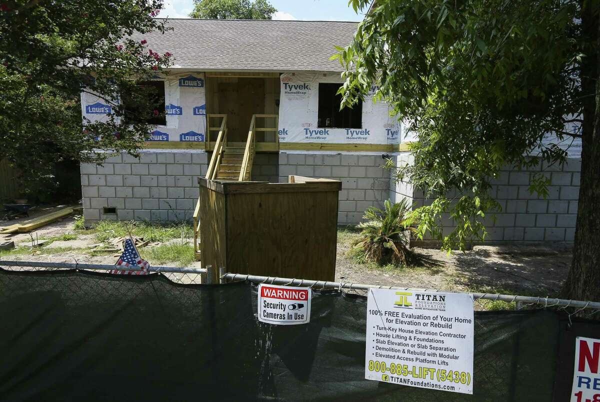An elevated home sits only partially completed along N. Braeswood Blvd., Wednesday, July 25, 2018 in Houston. Titan Homes was hired by the city to perform the elevations using mostly federal funds, but failed to complete them after running into financial problems. City Council on Wednesday will consider contracts to finish several home elevations abandoned by Titan.