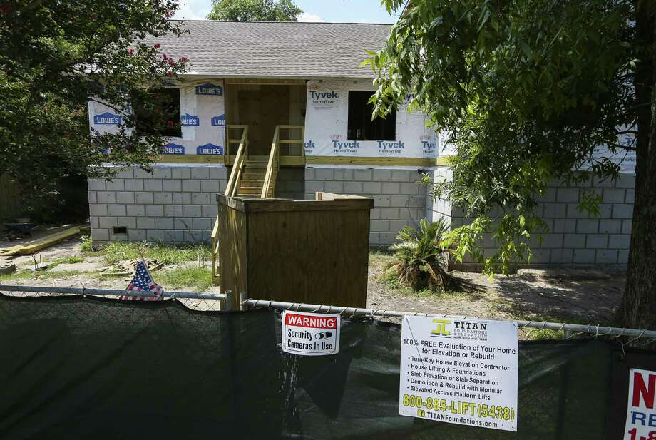 An elevated home sits only partially completed along N. Braeswood Blvd., Wednesday, July 25, 2018 in Houston. Titan Homes was hired by the city to perform the elevations using mostly federal funds, but failed to complete them after running into financial problems. City Council on Wednesday will consider contracts to finish several home elevations abandoned by Titan. Photo: Mark Mulligan, Staff Photographer / Houston Chronicle / © 2018 Mark Mulligan / Houston Chronicle